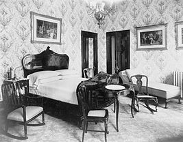 A bedroom in the Bellevue-Stratford, photographed by William H. Rau, circa 1905