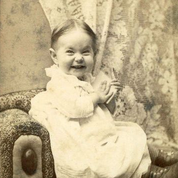 scrunchy faced smiling baby from 1900